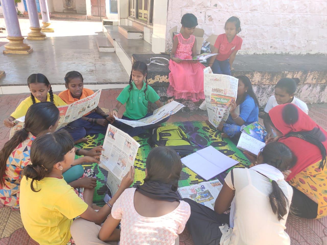 Children-in-News-Paper-Reading